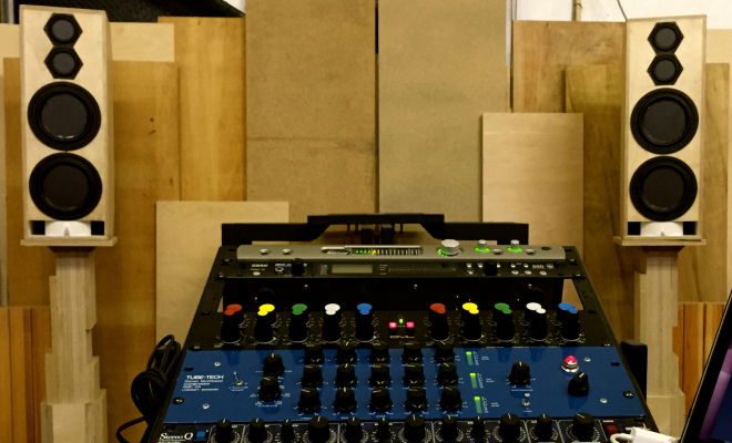 picture of audio mixing board and speakers